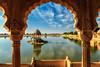 Gadi Sagar - artificial lake. View through arch. Jaisalmer, Rajasthan, India