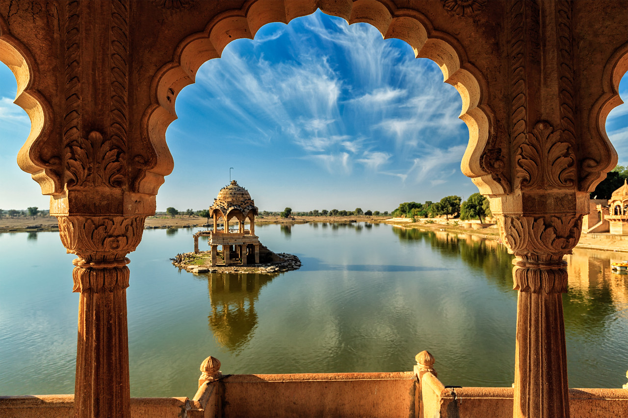 Gadi Sagar - artificial lake. View through arch. Jaisalmer, Rajasthan, India