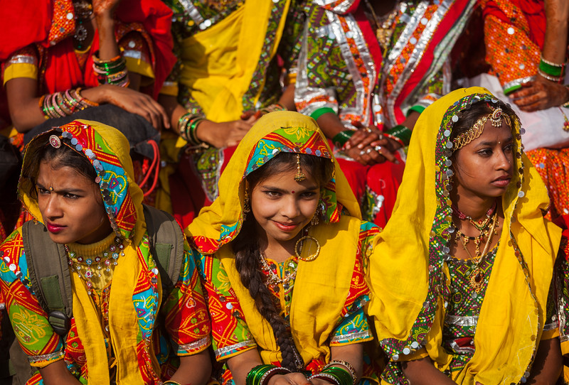 Girls in traditional Rajasthani clothing at Pushkar Mela (Camel Fair) in Pushar. Pushkar, Rajasthan, India