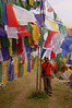 Yann hides beneath the prayer flags