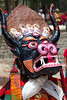 A senior monk wears one of the most elaborate masks