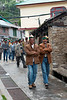 The village men, all wearing their Kinnauri caps, in a procession heading to the Kalpa Temple