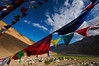 A view of Kaza from surrounding prayer flag draped hills.