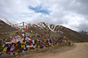 Prayer flags adorn a mountain pass.