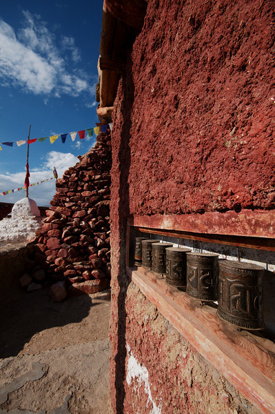 Rows of prayer wheels line the streets of Nako