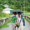 Yann sneaks under James and Antonia's umbrella.  Yann is so funny.