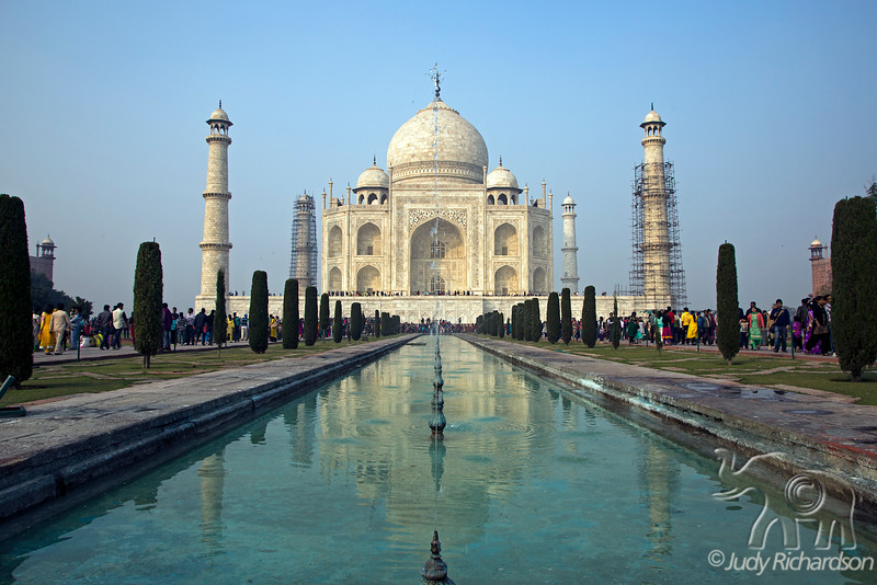 Taj Mahal from reflecting pool with fountains in afternoon