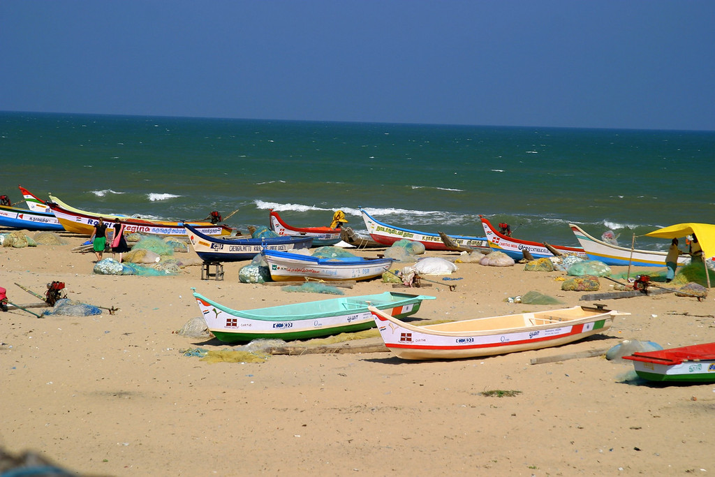 Fishing boats. The beach by the shore temple in Mamallapuram