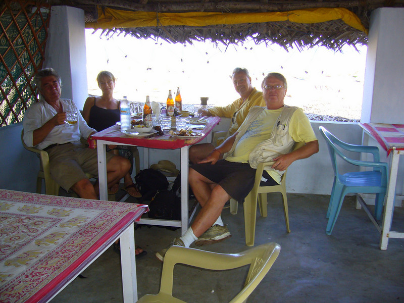 Wm, Jan, HBC and John on the beach by the shore temple in Mamallapuram
