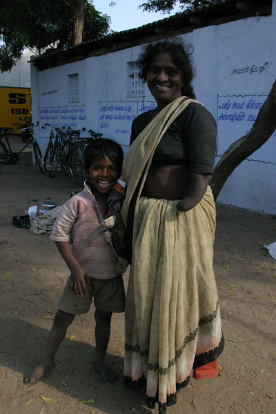 Mother and Son. She had lost both of her hands, but still with a wondeful smile. Train from Manamadurai Junction  to Rameswaram, Tamil Nadu, India
