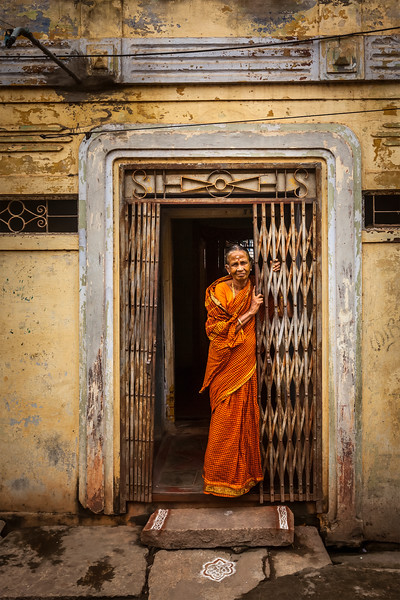 TIRUCHIRAPPALLI, INDIA - FEBRUARY 15, 2013: Unidentified India woman standing in the doorway of her house