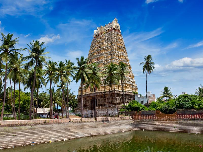 Gopura (tower) and temple tank of Lord Bhakthavatsaleswarar Temple.  Thirukalukundram (Thirukkazhukundram), near Chengalpet, Tamil Nadu, India