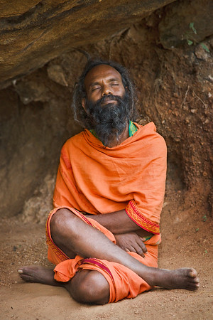 Sadhu meditating in cave