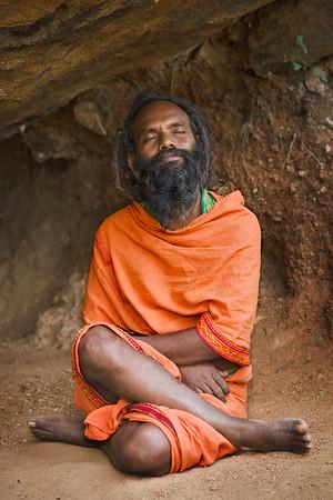 Sadhu meditating in cave