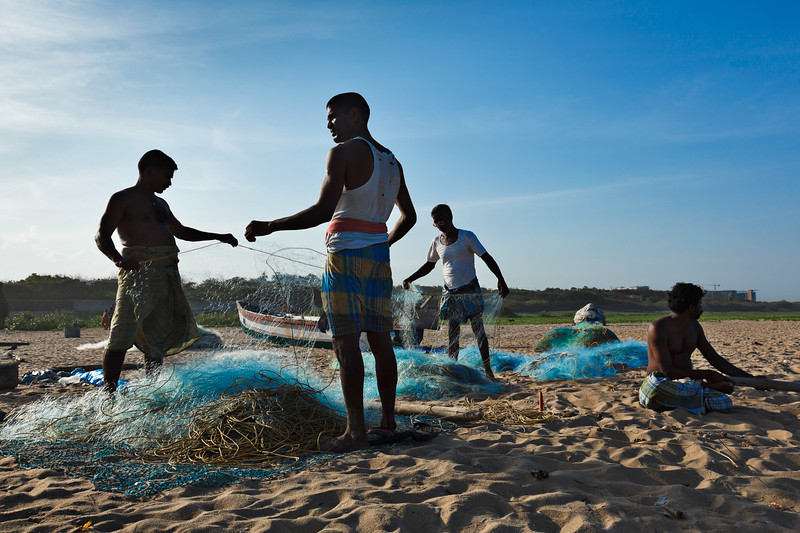 Fishermen working on the beach