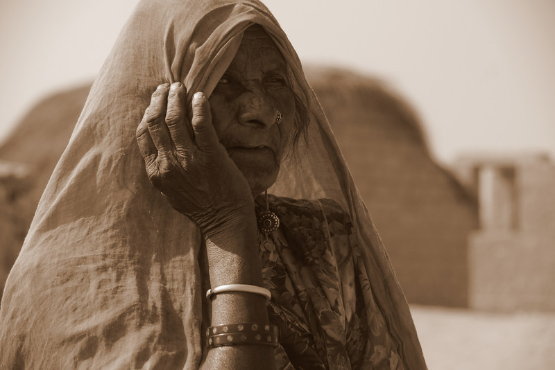 Today's daily travel photo is of a yodelling Indian gypsy lady that I met in a small village in the Thar Desert region of Rajasthan, India.