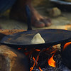 "Cooking over an open camp fire to make a chapati for lunch.  Travel photo from the Thar desert camel safari tour in Jaisalmer, Rajasthan - India. <a href=""http://nomadicsamuel.com"">http://nomadicsamuel.com</a>"