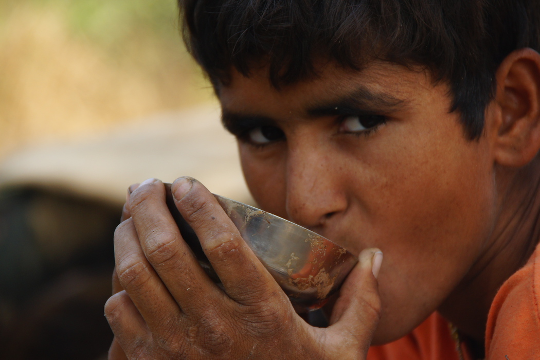 Boy Drinking Chai during our Thar Desert, India