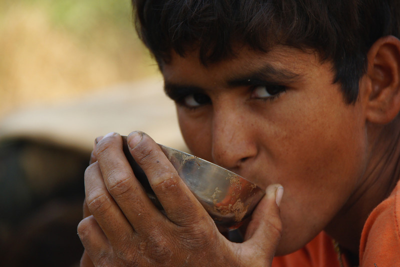 "Camel tour guide's nephew drinking a cup of Chai on our Thar Desert safari - Thar Desert, India.  This is a travel photo from the Thar Desert, India. <a href=""http://nomadicsamuel.com"">http://nomadicsamuel.com</a>"
