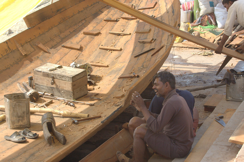 Varanasi Boat wrights, using only traditional boat building tools and methods, no power tools! Varanasi. Takes about one month to construct a boat this size.(March 2011)