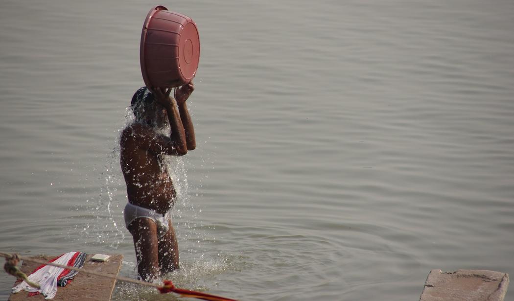 Man Bathing at a ghat in Varanasi, India