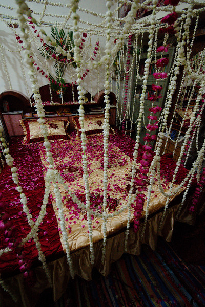 The Matrimonial Bed Decorated With Fresh Flowers And Petals