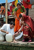 Helping Jitendra heave up the jug of Ganga water