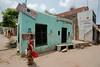Jyoti walks through the riverside village