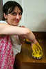 Lucie dipping her hand in the pithi. Pithi is a paste made with chickpea flour, turmeric and rosewater.