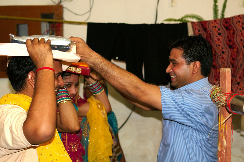 Family members bring up gifts for the parents of the groom