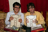 James and Yann display their gifts from Jitendra's family: tailored salwar suits for the wedding