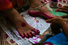 Married women have their feet painted pink