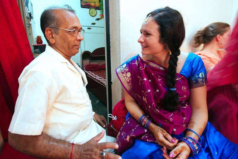 Lucie's cousin Sarah discussing with Jitendra's father
