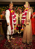 The exchange of flower garlands is complete, now the bride and groom must pose for photos