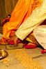 Jitendra pulls Lucie's foot through grains