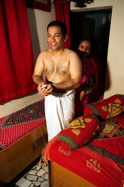 Jitendra escorted into the main room to begin wedding morning ceremonies