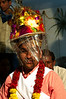 Jitendra's eyes are blocked by the ceremonial hat and its hanging tinsel
