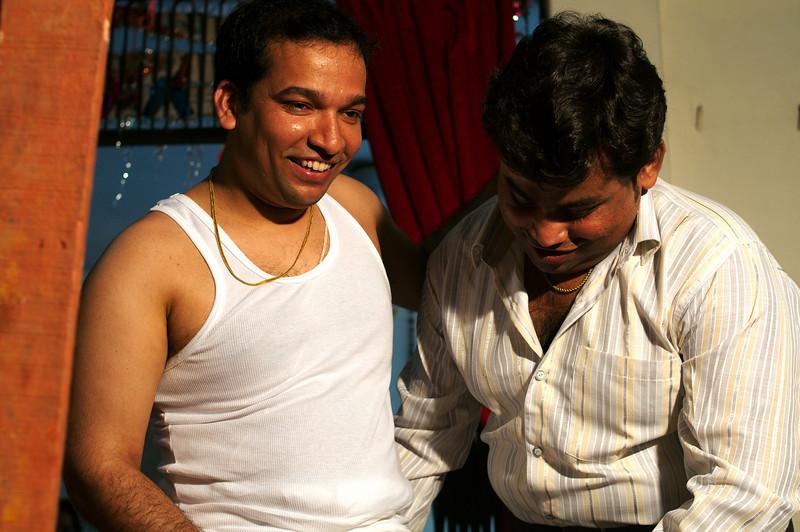 Prashant (Jitendra's brother-in-law)  dressing Jitendra
