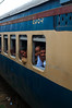 A passing train at one of many stops on the way to Kolkata