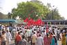 The crowd proceeds through downtown Kolkata