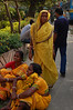 Ladies in yellow resting on the streets of Kolkata