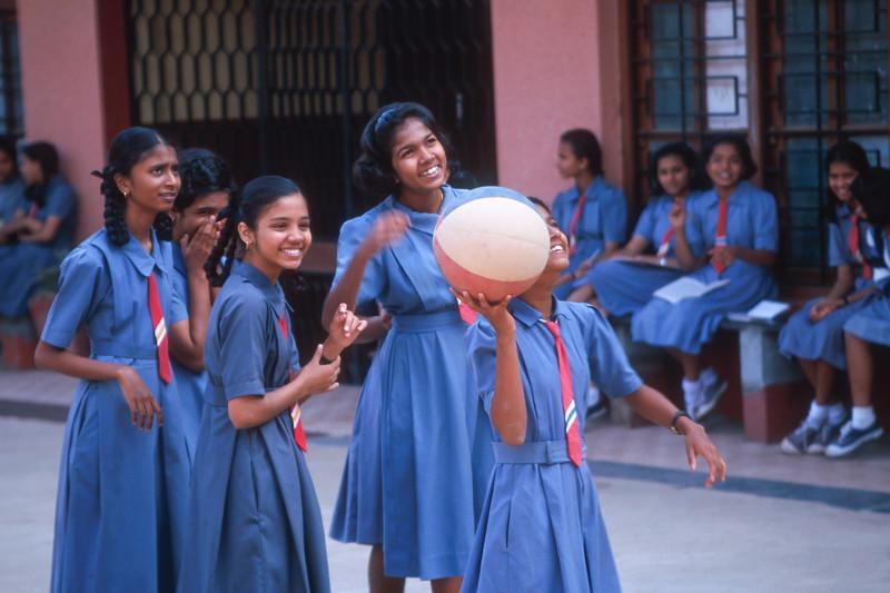Schoolgirls play basketball, Panjim, Goa, India.