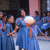 Schoolgirls play basketball, Panjim, Goa, India.
