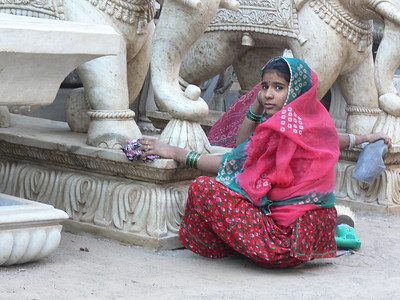 Girl cleaning marble statues in Jodhpur, India.