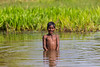 Asia. India. Child bathing in the local pond in Madya Pradesh.