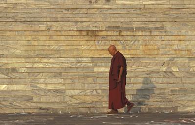 Monk circumambulating Sera Monastery in Bylakuppe, India.