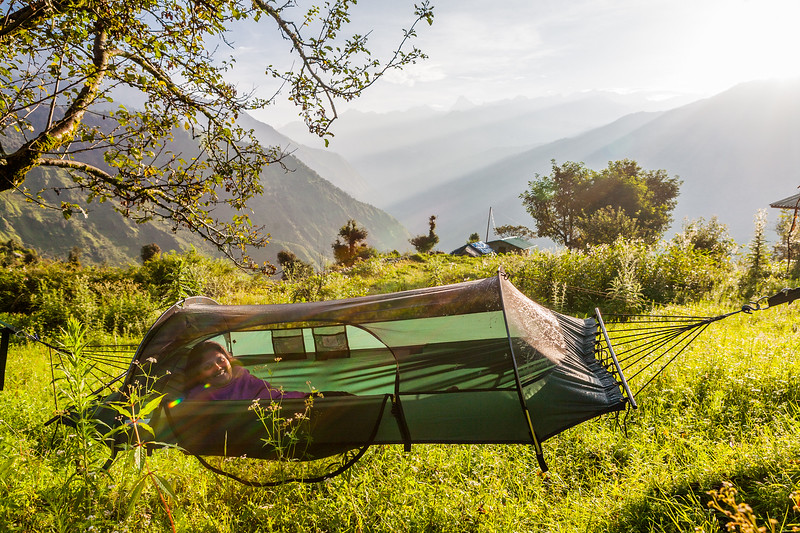 Relaxing in a Lawson hammock at The Goat Village, Raithal surrounded by the Himalayas