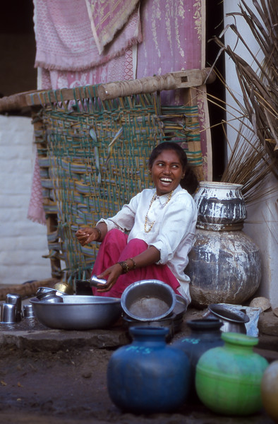 Woman washes dishes, Hampi, India.