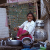 Woman washes dishes, Hampi, India.