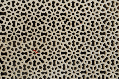 "3"" thick marble slab carved like lattice.  The red string was tied on by a pilgrim in the hopes of having a son.  Fatehpur Sikri, Agra, India"